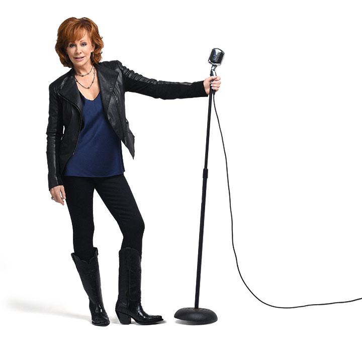 31b4a2b4787 Reba standing next to microphone
